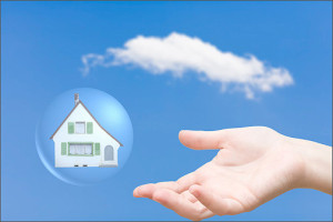 Home in sky with protecting hand